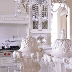 Kitchens - Elegant accessories and chanderier featured in this over the top kitchen