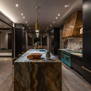 Inspiration for a large contemporary galley eat-in kitchen in Other with an undermount sink, flat-panel cabinets, black cabinets, granite benchtops, grey splashback, ceramic splashback, black appliances, ceramic floors, multiple islands, beige floor and grey benchtop.
