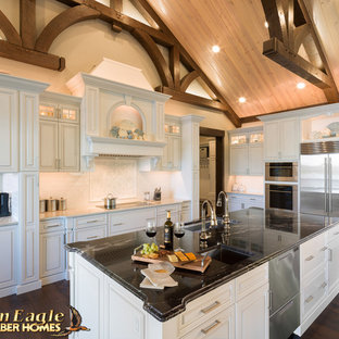 Elegant Gourmet kitchen, with two islands painted white cabinets