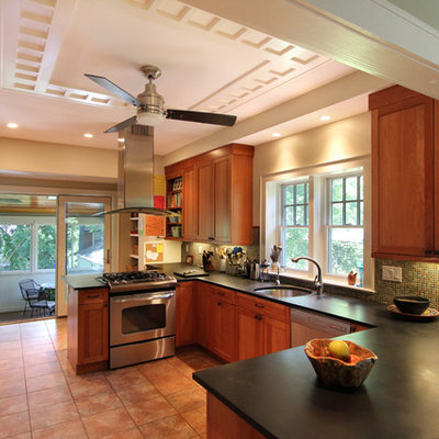 Arts and crafts u-shaped kitchen photo in DC Metro with stainless steel appliances, a single-bowl sink, recessed-panel cabinets, medium tone wood cabinets, multicolored backsplash and mosaic tile backsplash