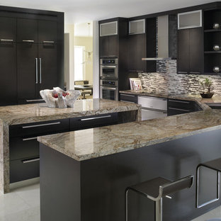 Inspiration for a mid-sized contemporary u-shaped porcelain floor and white floor enclosed kitchen remodel in Miami with an undermount sink, flat-panel cabinets, black cabinets, marble countertops, black backsplash, matchstick tile backsplash, paneled appliances and an island