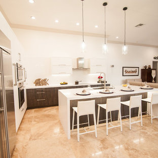Large contemporary eat-in kitchen designs - Example of a large trendy l-shaped eat-in kitchen design in Miami with an undermount sink, flat-panel cabinets, brown cabinets, quartz countertops, white backsplash, stone slab backsplash, stainless steel appliances and an island