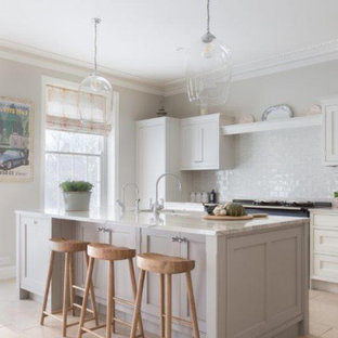 Inspiration for a large traditional kitchen in Hampshire with an integrated sink, shaker cabinets, grey cabinets, marble benchtops, porcelain splashback, coloured appliances, with island and white benchtop.