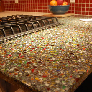 Mid-sized contemporary eat-in kitchen photos - Eat-in kitchen - mid-sized contemporary l-shaped eat-in kitchen idea in Minneapolis with a farmhouse sink, recessed-panel cabinets, light wood cabinets, recycled glass countertops, red backsplash, glass tile backsplash, stainless steel appliances and an island