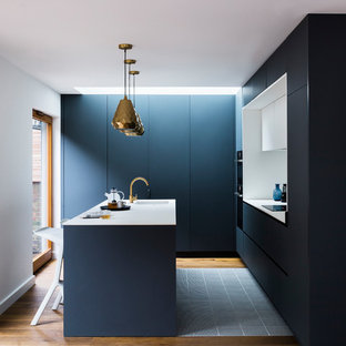 Small Modern Kitchen Pictures   Example Of A Small Minimalist L Shaped  Medium Tone Wood
