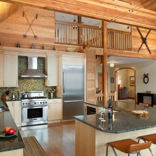 Rustic kitchen inspiration - Inspiration for a rustic l-shaped kitchen remodel in Philadelphia with flat-panel cabinets, light wood cabinets, multicolored backsplash, mosaic tile backsplash and stainless steel appliances