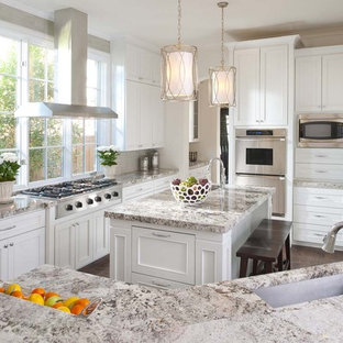 Traditional kitchen ideas - Inspiration for a timeless kitchen remodel in Dallas with stainless steel appliances, granite countertops, recessed-panel cabinets, white cabinets and a single-bowl sink