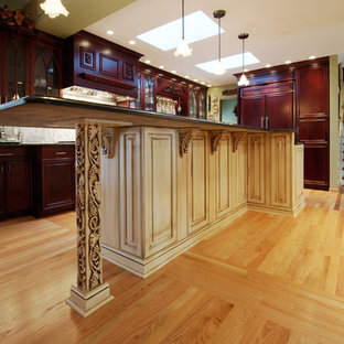 Large transitional eat-in kitchen ideas - Example of a large transitional light wood floor eat-in kitchen design in Chicago with a farmhouse sink, raised-panel cabinets, red cabinets, granite countertops, metallic backsplash, metal backsplash, stainless steel appliances and an island