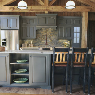 Design ideas for a country galley kitchen in Other with raised-panel cabinets, grey cabinets, multi-coloured splashback, stainless steel appliances and slate splashback.