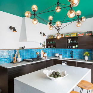 Mid-sized eclectic enclosed kitchen remodeling - Example of a mid-sized eclectic l-shaped enclosed kitchen design in Chicago with an undermount sink, flat-panel cabinets, dark wood cabinets, quartz countertops, blue backsplash, terra-cotta backsplash, stainless steel appliances and an island