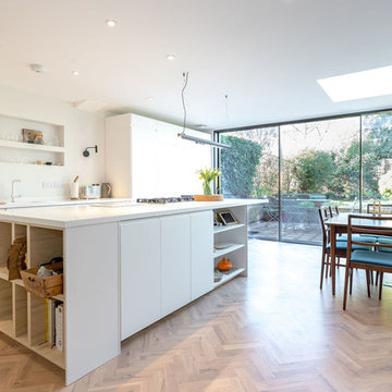 Bright open plan kitchen diner with full width sliding patio doors