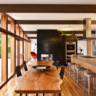 This is an example of a midcentury kitchen in Seattle with concrete benchtops.
