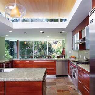Inspiration for a mid-sized contemporary u-shaped open plan kitchen in Los Angeles with flat-panel cabinets, dark wood cabinets, stainless steel appliances, slate floors, granite benchtops, green splashback, glass tile splashback, with island and green benchtop.