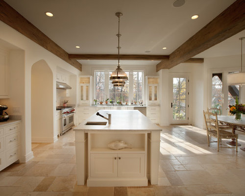 Traditional Kitchen Idea In Minneapolis With Stainless Steel Appliances And Travertine Floors