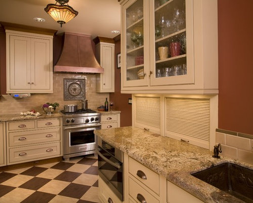 Example Of A Classic Kitchen Design In Portland With Glass Front Cabinets,  Stainless Steel