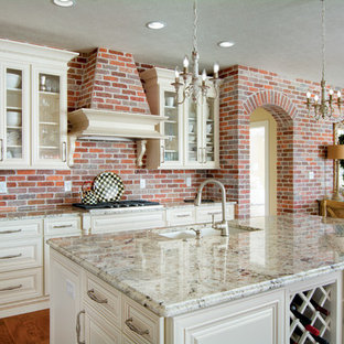 Large traditional eat-in kitchen ideas - Large elegant dark wood floor eat-in kitchen photo in Other with raised-panel cabinets, white cabinets, granite countertops, red backsplash, an island and an undermount sink