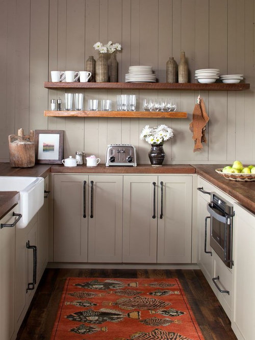 Small Transitional U Shaped Kitchen Photo In Atlanta With Wood Countertops,  A Farmhouse Sink