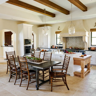 Mediterranean Eat In Kitchen Designs   Example Of A Tuscan Beige Floor  Eat In
