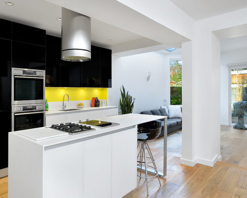 Inspiration For A Modern Galley Light Wood Floor Open Concept Kitchen  Remodel In Toronto With An