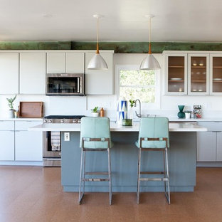 Eclectic kitchen designs - Example of an eclectic single-wall cork floor kitchen design in Los Angeles with flat-panel cabinets, white cabinets, quartz countertops and an island