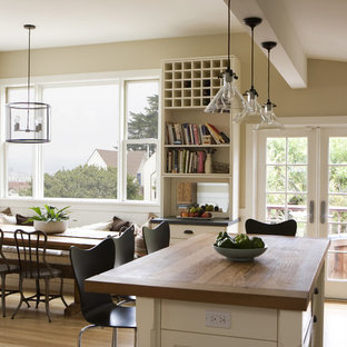 Inspiration for a country eat-in kitchen in San Francisco with wood benchtops.