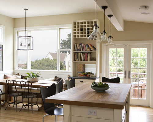 over island lighting in kitchen. country eatin kitchen photo in san francisco with wood countertops over island lighting i