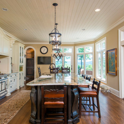 Inspiration for a timeless galley eat-in kitchen remodel in Other with raised-panel cabinets and beige cabinets