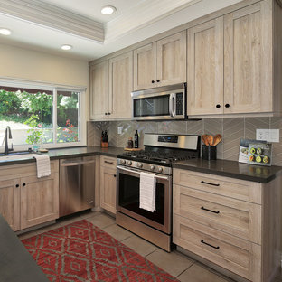 Mid-sized transitional kitchen remodeling - Kitchen - mid-sized transitional u-shaped kitchen idea in Orange County with an undermount sink, shaker cabinets, distressed cabinets, quartz countertops, stainless steel appliances, an island and gray countertops