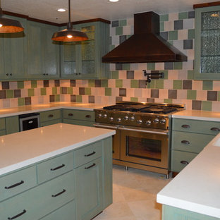Inspiration for a mid-sized eclectic u-shaped eat-in kitchen in Los Angeles with a farmhouse sink, shaker cabinets, green cabinets, quartz benchtops, multi-coloured splashback, terra-cotta splashback, stainless steel appliances, travertine floors and with island.