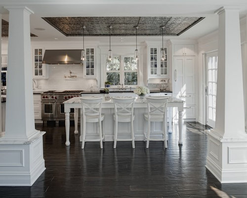 elegant kitchen photo in chicago with stainless steel appliances glassfront cabinets white