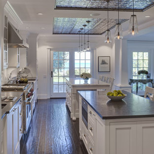 Inspiration for a traditional kitchen in Chicago with recessed-panel cabinets, white cabinets, multiple islands and black worktops.