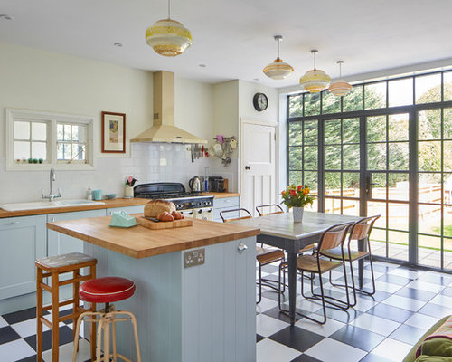 Eclectic open concept kitchen ideas - Example of an eclectic multicolored  floor open concept kitchen design