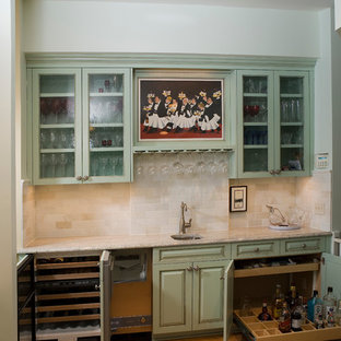 Example of a classic l-shaped eat-in kitchen design in Minneapolis with an undermount sink, raised-panel cabinets, blue cabinets, granite countertops, white backsplash, stone tile backsplash and paneled appliances