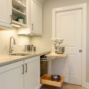 Small transitional eat-in kitchen appliance - Example of a small transitional galley light wood floor eat-in kitchen design in Chicago with an undermount sink, recessed-panel cabinets, white cabinets, quartzite countertops, gray backsplash, stone slab backsplash, stainless steel appliances and a peninsula