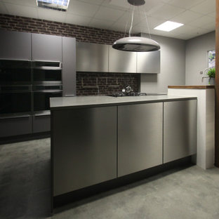 Mid-sized modern eat-in kitchen ideas - Inspiration for a mid-sized modern single-wall linoleum floor and gray floor eat-in kitchen remodel in Cheshire with a drop-in sink, flat-panel cabinets, gray cabinets, quartzite countertops, brown backsplash, brick backsplash, paneled appliances, an island and gray countertops