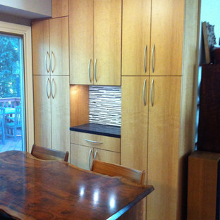 Mid-sized contemporary enclosed kitchen designs - Example of a mid-sized trendy u-shaped bamboo floor enclosed kitchen design in Philadelphia with an undermount sink, flat-panel cabinets, light wood cabinets, granite countertops, multicolored backsplash, porcelain backsplash, stainless steel appliances and no island