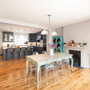 Photo of a classic kitchen in London with medium hardwood flooring and brown floors.