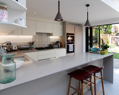 This Is An Example Of A Medium Sized Modern U Shaped Kitchen In London With