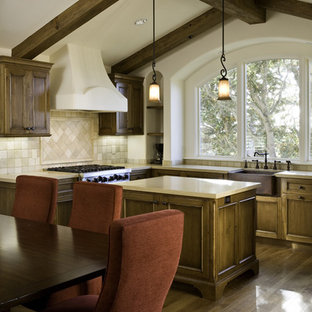 Inspiration for a mediterranean eat-in kitchen remodel in Other with medium tone wood cabinets and beige backsplash