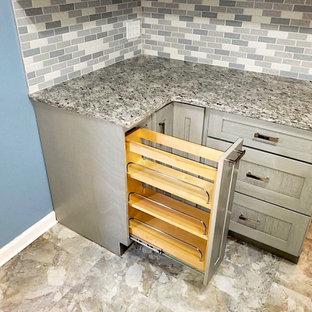 Small modern galley separate kitchen in DC Metro with an undermount sink, shaker cabinets, grey cabinets, granite benchtops, grey splashback, mosaic tile splashback, stainless steel appliances, vinyl floors, beige floor and grey benchtop.