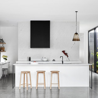 Design ideas for a contemporary u-shaped kitchen in Melbourne with with island, louvered cabinets, white cabinets, white splashback, white appliances, grey floor and white benchtop.