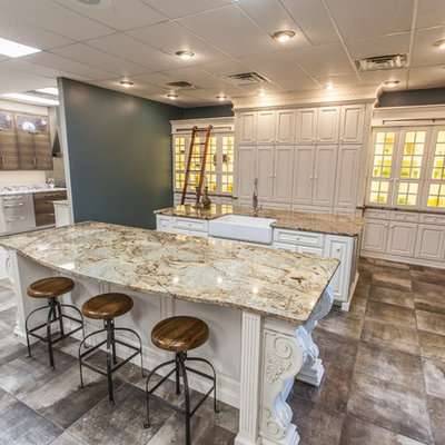 Kitchen - large transitional galley kitchen idea in Other with a farmhouse sink, granite countertops, glass-front cabinets, beige cabinets and an island