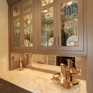 Traditional kitchen ideas - Elegant single-wall kitchen photo in Chicago with recessed-panel cabinets, brown cabinets and mirror backsplash