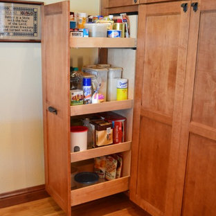 Inspiration for a large craftsman l-shaped kitchen pantry remodel in Denver with shaker cabinets and light wood cabinets