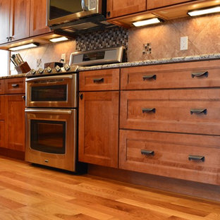 Large arts and crafts l-shaped eat-in kitchen photo in Denver with a single-bowl sink, recessed-panel cabinets, medium tone wood cabinets, granite countertops, ceramic backsplash, stainless steel appliances and an island
