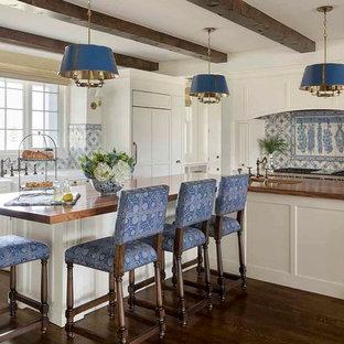 Elegant dark wood floor kitchen photo in Los Angeles with shaker cabinets, white cabinets, ceramic backsplash, paneled appliances, multicolored backsplash, an island and wood countertops