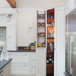 Large contemporary eat-in kitchen ideas - Example of a large trendy l-shaped slate floor eat-in kitchen design in Kent with an undermount sink, shaker cabinets, granite countertops, glass sheet backsplash and an island