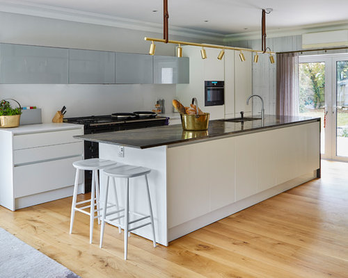 kitchens with track lighting. Inspiration For A Contemporary Galley Open Plan Kitchen In Sussex With Light Hardwood Flooring, An Kitchens Track Lighting G