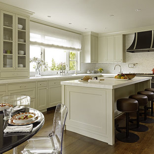 Example of a transitional kitchen design in San Francisco with recessed-panel cabinets, beige cabinets, white backsplash and black appliances