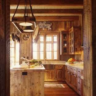 Rustic kitchen designs - Example of a mountain style kitchen design in San Francisco with a farmhouse sink